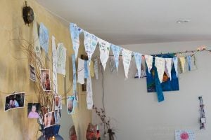 The birth pennants hanging above the birth space made by Rose's family, midwife and fellow Auckland HomeBirth Community members.