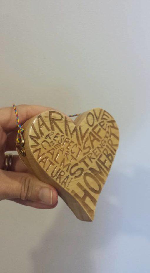Wooden HOMEBIRTH heart in hand